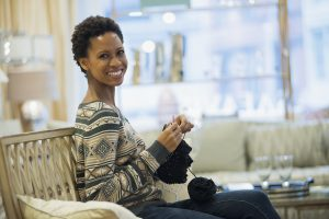 Woman relaxing at home with her knitting